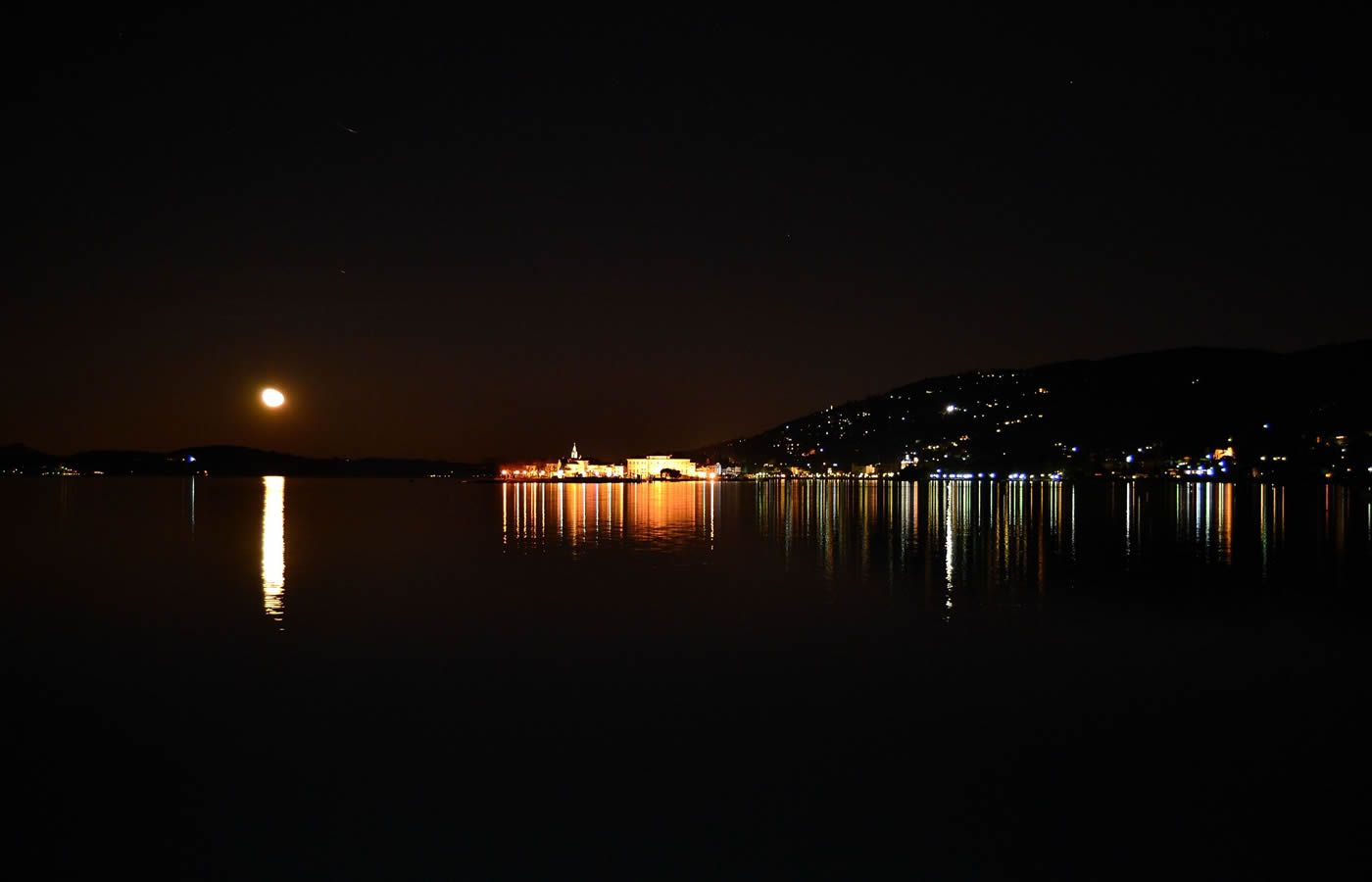 The Borromean Islands from Baveno square in a full moon night